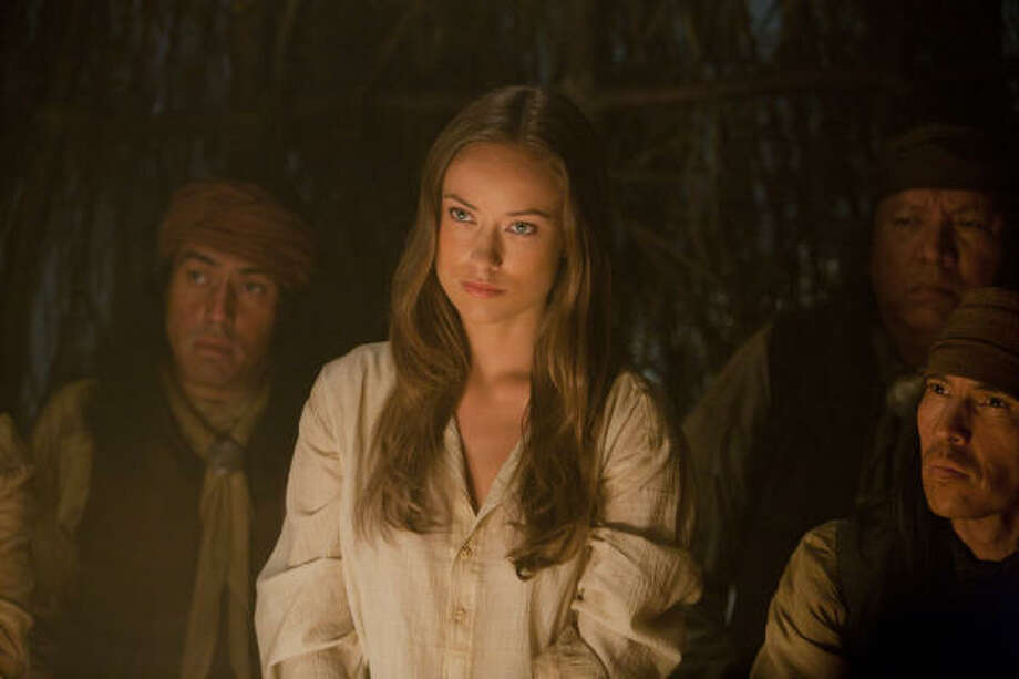 Olivia Wilde plays an elusive traveler in Cowboys & Aliens, one of seven films she has in various stages of completion. Photo: Zade Rosenthal, Universal Studios