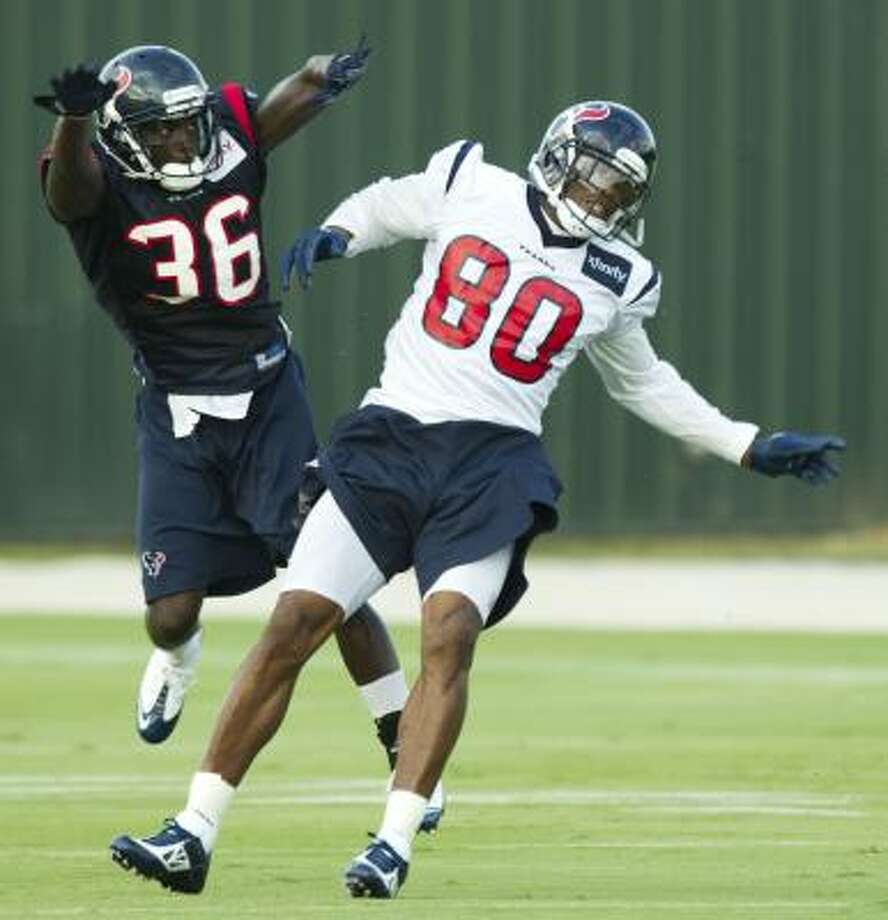 Texans wide receiver Andre Johnson could not participate Wednesday because of his dislocated finger. Photo: Brett Coomer, Chronicle