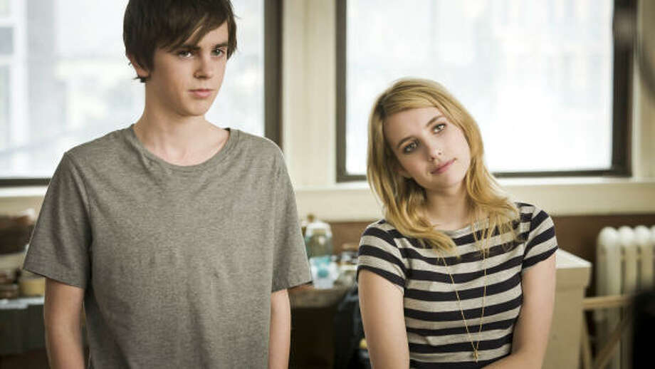 Freddie Highmore and Emma Roberts star in The Art of Getting By, a film about angsty teens who like to party. Highmore says his film presents teens in a more adult representation. Photo: MARK SCHAFER, FOX SEARCHLIGHT FILMS