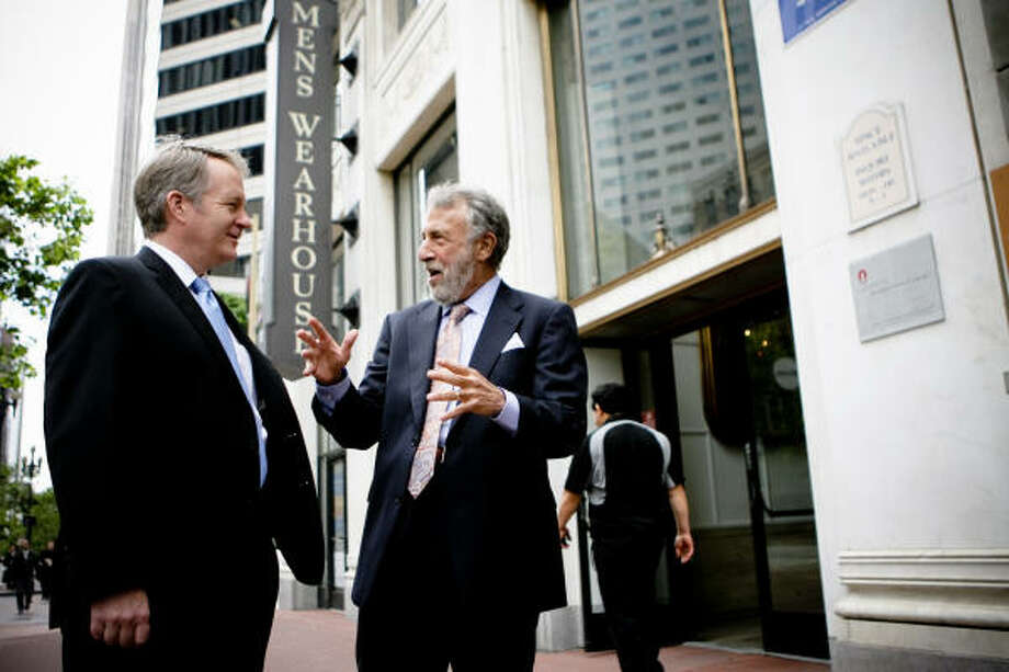 Douglas Ewert, left, became the CEO of Men's Wearhouse last week, as founder, chairman and former CEO George Zimmer took the title of executive chairman of the board. Though the chain has its headquarters in Houston, Zimmer and Ewert work from offices near San Francisco. Photo: Vasna Wilson :, For The Chronicle