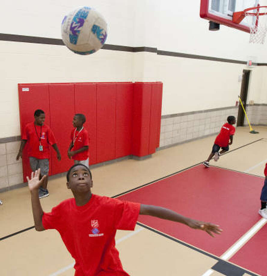 Derrick Adams II, 12, looks to serve the ball as he plays volleyball Friday in the new Boys & Girls Club gym. The Salvation Army Greater Houston Command replaced a former center that was ripped apart by Hurricane Ike. Photo: Nick De La Torre, Chronicle