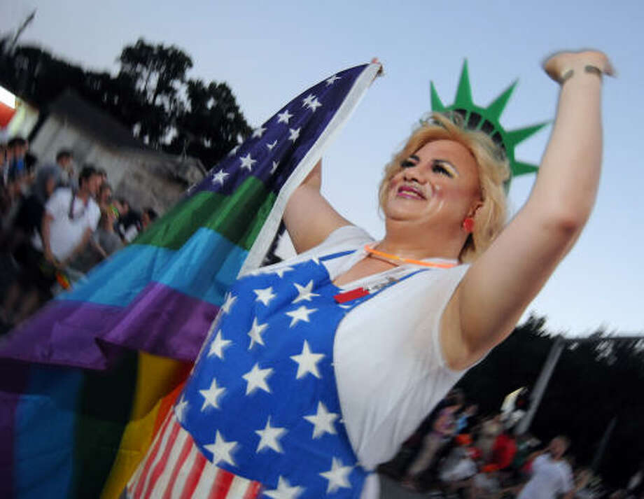 Tanya Hyde greets the crowd at the Pride Parade along Westheimer on Saturday. Photo: Dave Rossman, Chronicle