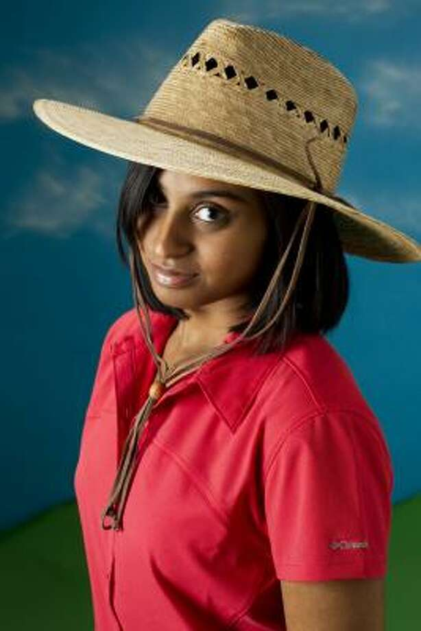 Zahara Ahmed is dressed to tackle garden chores  in a Tula hand-woven palm gardener lattice hat with UPF 30 and a 4-inch brim. Ultra-lightweight, it's about $30 at Another Place in Time. Columbia's high-tech, moisture-wicking Silver Ridge stretch shirt with UPF 30 is $40 at REI. Photo: Brett Coomer, Houston Chronicle