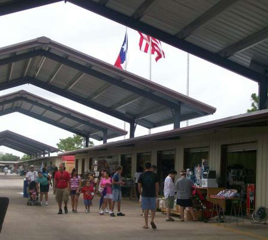 Traders Village has installed custom shade structures on eight streets within its 107-acre flea market complex in northwest Houston. The center's four expo buildings also received new paint. Photo: Traders Village