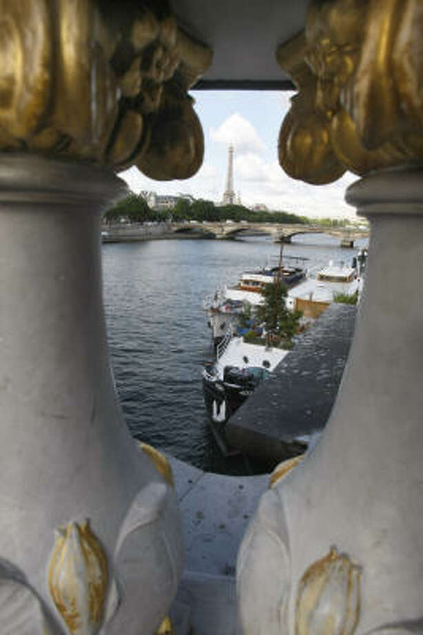 A view of the Seine River through the Alexandre III bridge in Paris. Photo: Remy De La Mauviniere, Associated Press