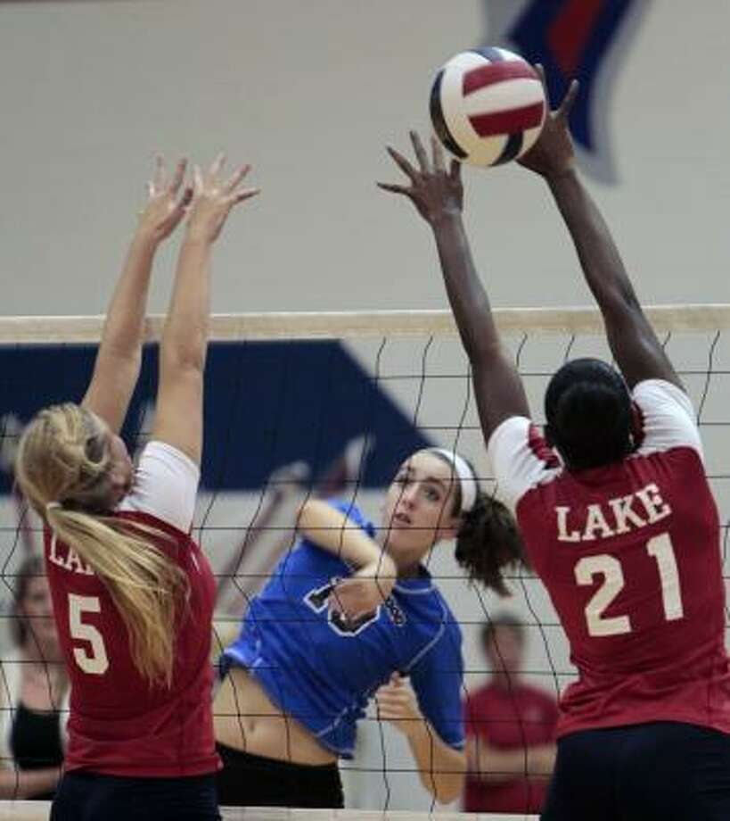 Friendswood's Shannon Ellis sneaks a shot past Clear Lake's Sarah Sciacca (5) and Kiara Wright (21) on Tuesday night. Photo: Cody Duty, Chronicle