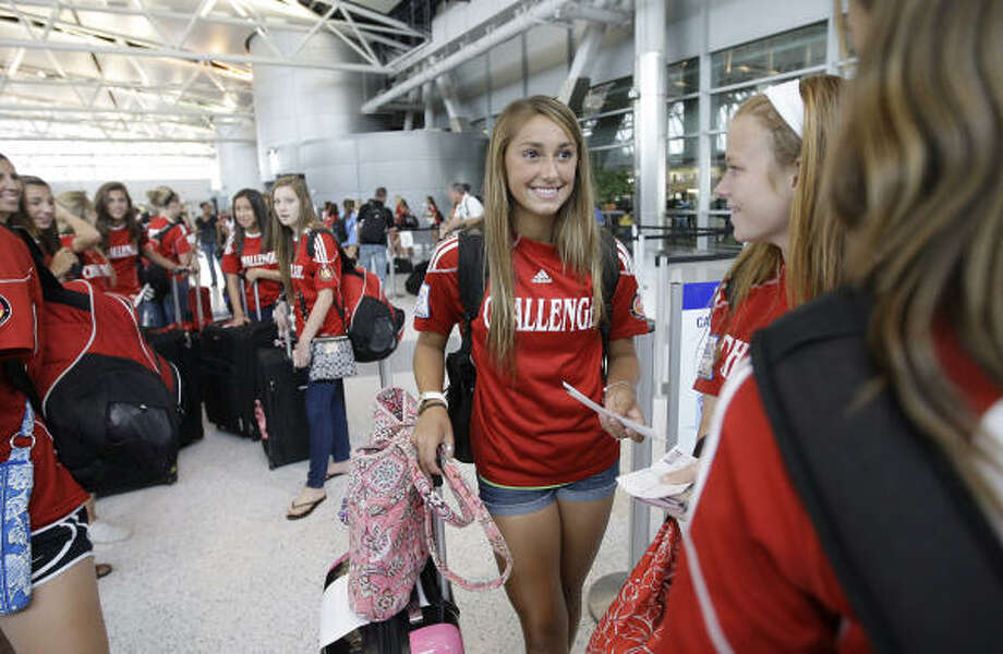 U.S. U-15 national team player Haley Pounds, center, and her Challenge teammates prepare for a flight to Denver to compete in the ECNL national tournament. Photo: Karen Warren, Chronicle
