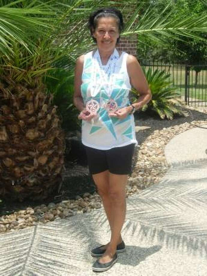FLEET-FOOTED: Delores Henry, 60, earned bronze medals in the 5K and 10K running races at the National Senior Games. Photo: Courtesy, Delores Henry