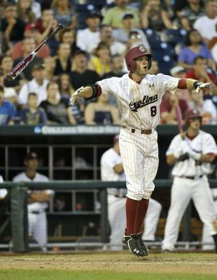 South Carolina's Scott Wingo jumps in the air after knocking in the winning run against A&M in the bottom of the ninth inning on Sunday. Photo: Ted Kirk, Associated Press