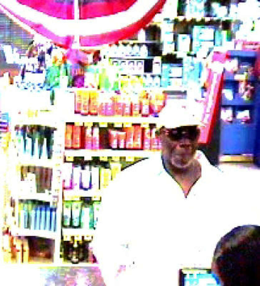 Surveillance photo of a man robbing the IBC Bank in the HEB store at 7405 FM 1960 in northeast Harris County last weekend. Photo: FBI.gov