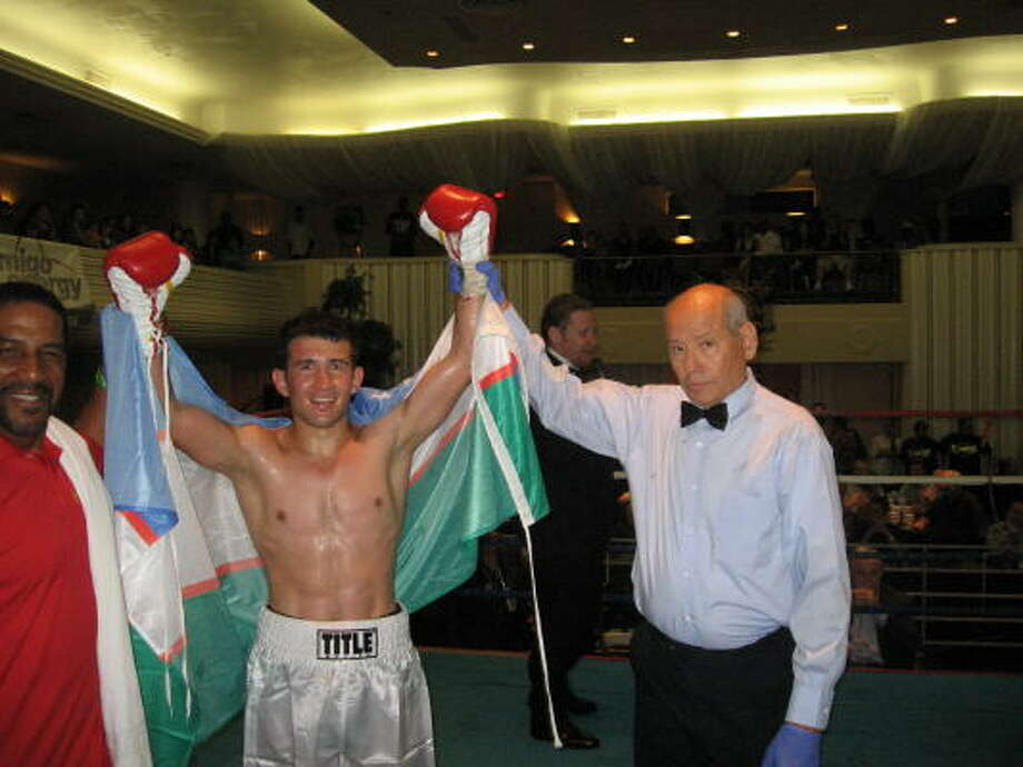 Bahodir Mamajanov made a successful pro debut with trainer Ken Richardson, left, at the Houston Club. Photo: Peter Lim, For The Chronicle