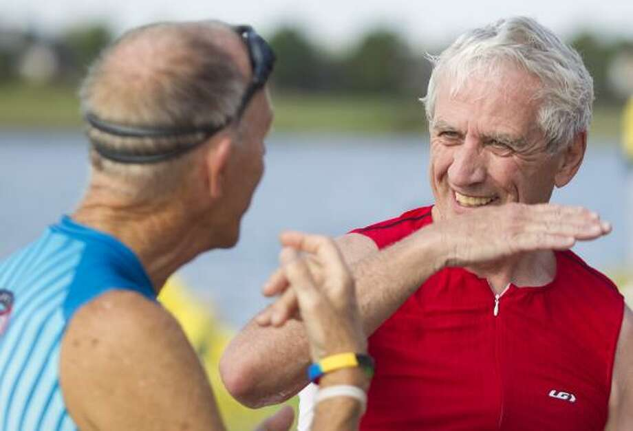 The Senior Games' spirit of friendly competition is shown by Tom Lynch, right, of Alexandria, Minn., and Arby Kitzman of Morro Bay, Calif., as they discuss swimming gear and techniques before the triathlon. Photo: Nick De La Torre, Chronicle