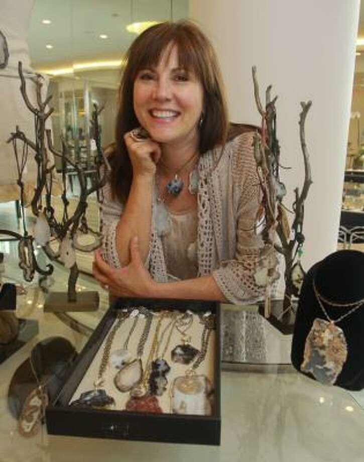 Texas jewelry designer Kathy Bracewell shows a few of her creations. Photo: Gary Fountain, For The Chronicle