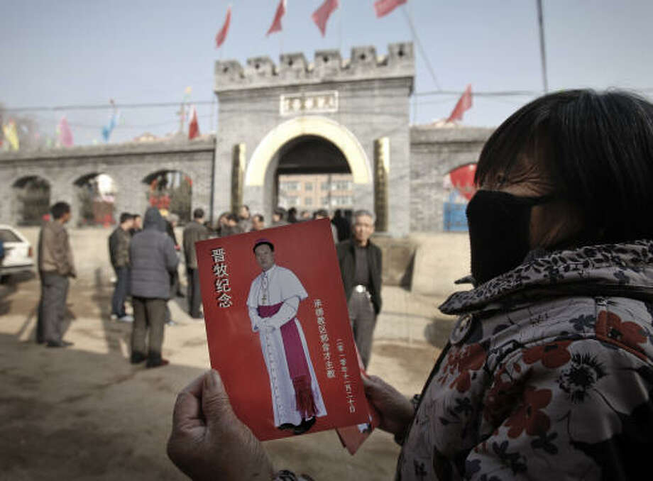 A villager shows a leaflet with a picture of Bishop Joseph Guo Jincai, which was distributed in November 2010 by worshipers after the bishop ordination ceremony in Chengde. Photo: ANDY WONG, ASSOCIATED PRESS