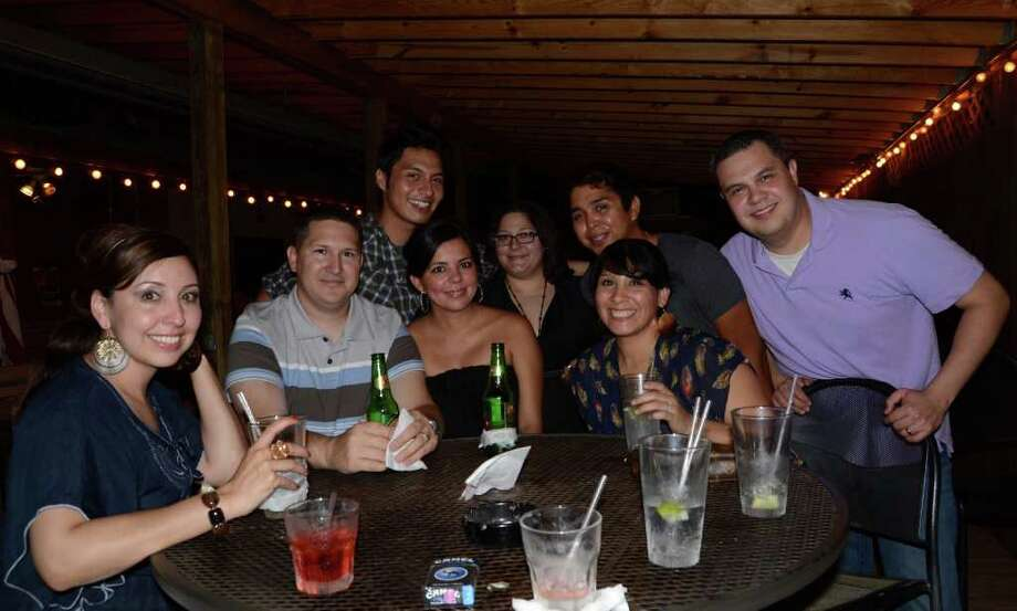 Friends Jessica Leal (bottom, left to right), Dyrer Villarreal, Lisa Villarreal, Sarah Longoria and Christopher Longoria (top left), Stephanie Marie, Roger Garcia and Jim Longoria relax after the work week at Heat. ROBIN JOHNSON / SPECIAL TO THE EXPRESS-NEWS