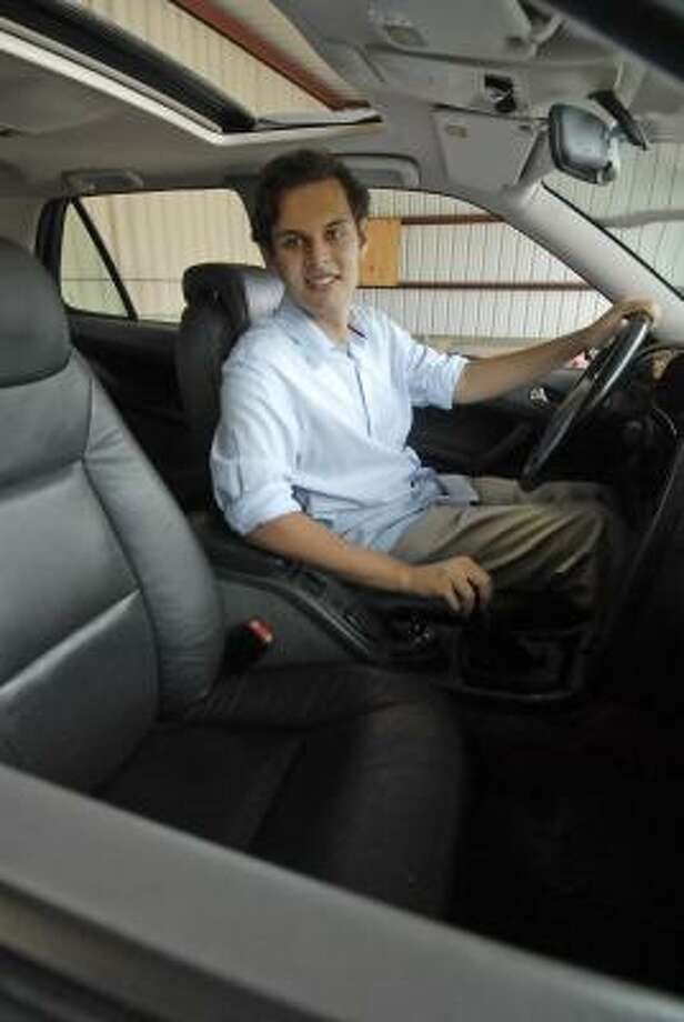 Sebastian Gupta sits in the Saab automobile which he rebuilt and will donate to The Women's Center. Photo: Tony Bullard, ALL