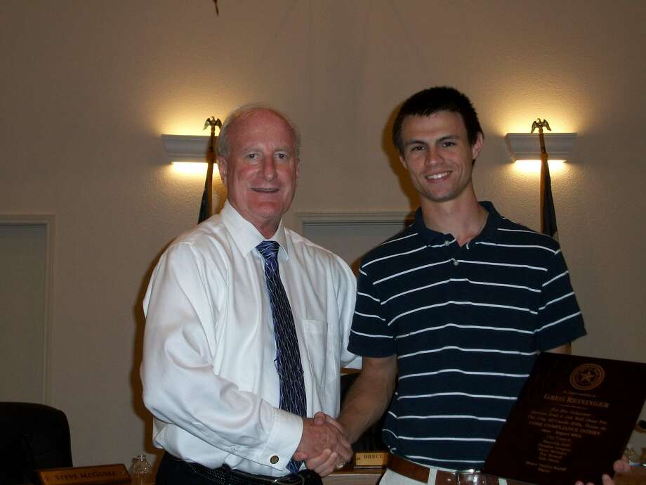 City Manager Michael Steel (left) presents a plaque of appreciation to city intern Greg Reininger at the Aug. 9 Castle Hills City Council meeting. Photo: Photo Courtesy  Of The City Of Castle Hills