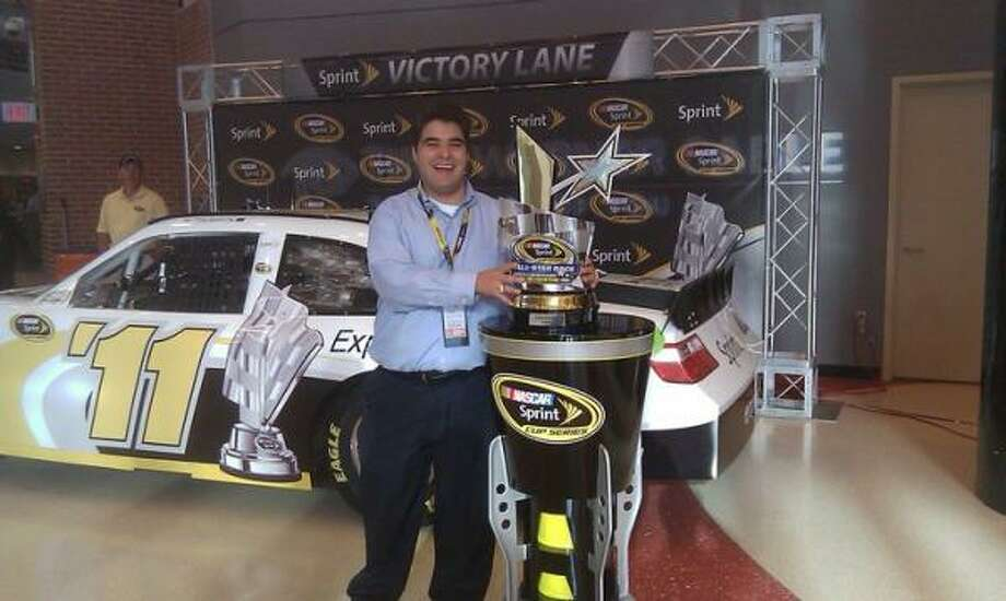 Matthew Esqueda, a Memorial High graduate, poses with the NASCAR Sprint Cup Series All-Star trophy. Photo: NASCAR