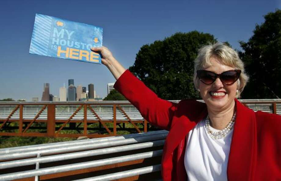 Mayor Annise Parker shows her favorite spot in Houston at Buffalo Bayou Park on the new pedestrian bridge over Buffalo Bayou with a great view of downtown. Photo: Johnny Hanson, Houston Chronicle