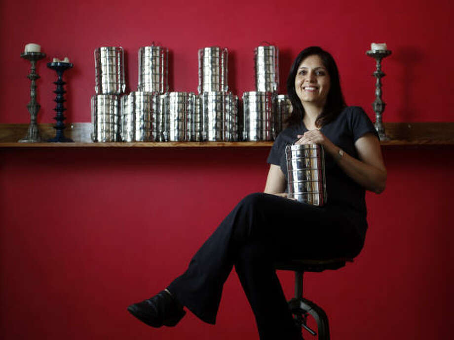 Anita Jaisinghani says her Pondicheri restaurant will feature a lunch box called a tiffin, a tradition in India, for takeout. There is an upfront deposit of $25 for the system. Customers can return the tiffins unwashed, and Pondicheri will clean them. Photo: Karen Warren :, Chronicle