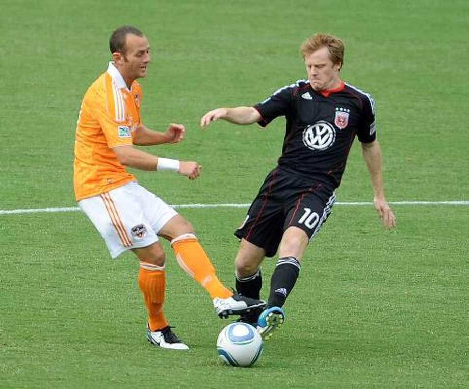 Dynamo midfielder Brad Davis, left, leads Major League Soccer in assists with nine. Photo: Chuck Myers, McClatchy-Tribune News Service