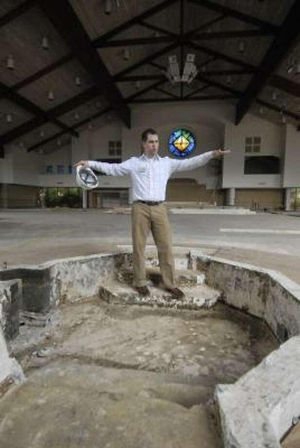TONY BULLARD: FOR THE CHRONICLE UNDER CONSTRUCTION: Charles Butler, Prince of Peace Catholic Community communications director, shows the area that will feature the new baptismal pond. Once construction is complete, the center will encompass 27,500 square feet. Photo: Tony Bullard, ALL