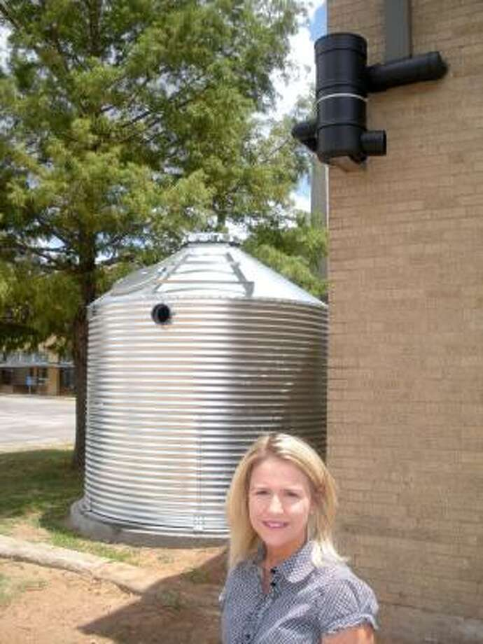 Richmond City Manager Teri Vela stands next to the rainwater harvesting system at City Hall. Photo: B.J. Pollock, For The Chronicle