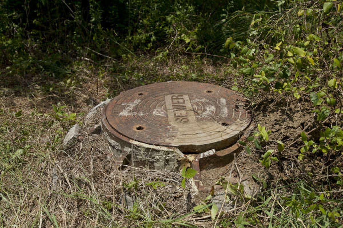 A 25-year-old League City man identified as Kevin Gonterman was rescued Monday, 30 feet down in this manhole. The cover was nearby when he was found.