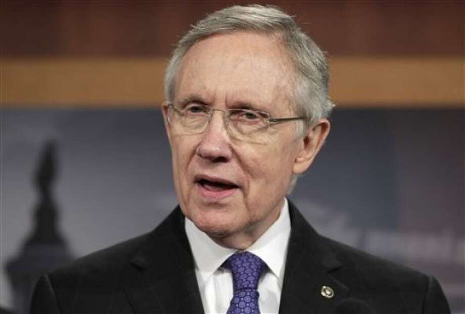 Senate Majority leader Harry Reid of Nev., speaks to reporters on Capitol Hill in Washington, Monday, July 25, 2011, as he announced a new proposal to solve the debt limit crisis.  (AP Photo/J. Scott Applewhite) Photo: J. Scott Applewhite, AP