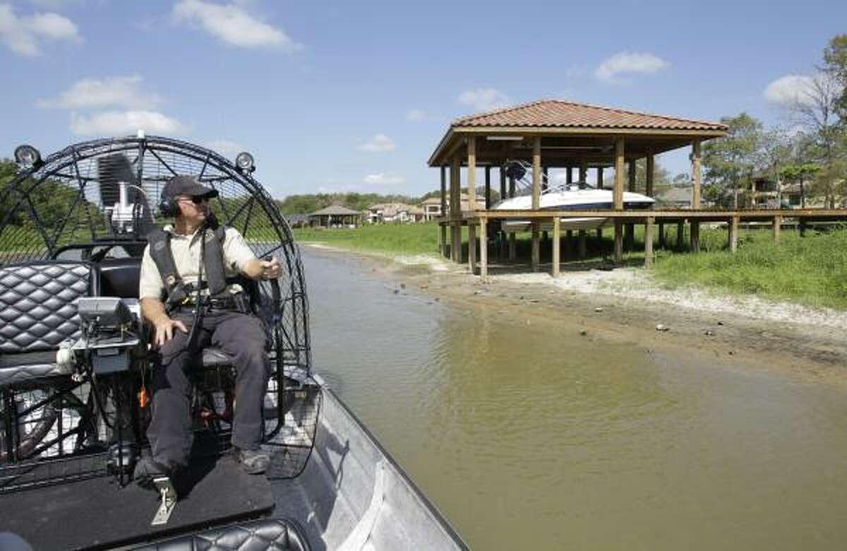 Texas game warden Kevin Creed's patrol of Lake Houston on Wednesday revealed boats in landlocked boathouses.