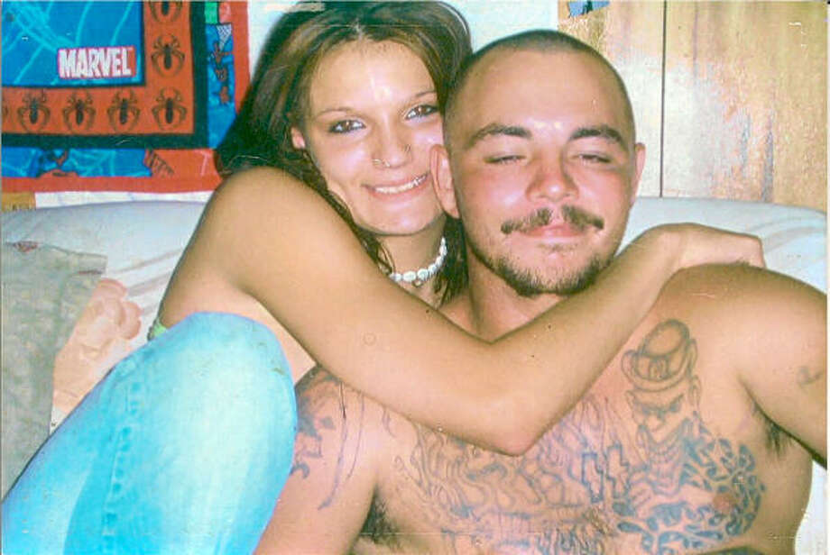 Tanya Smith, posing with her late boyfriend Dennis Clem, is serving two life terms in a Louisiana prison and is affiliated with the Aryan Circle of Texas.