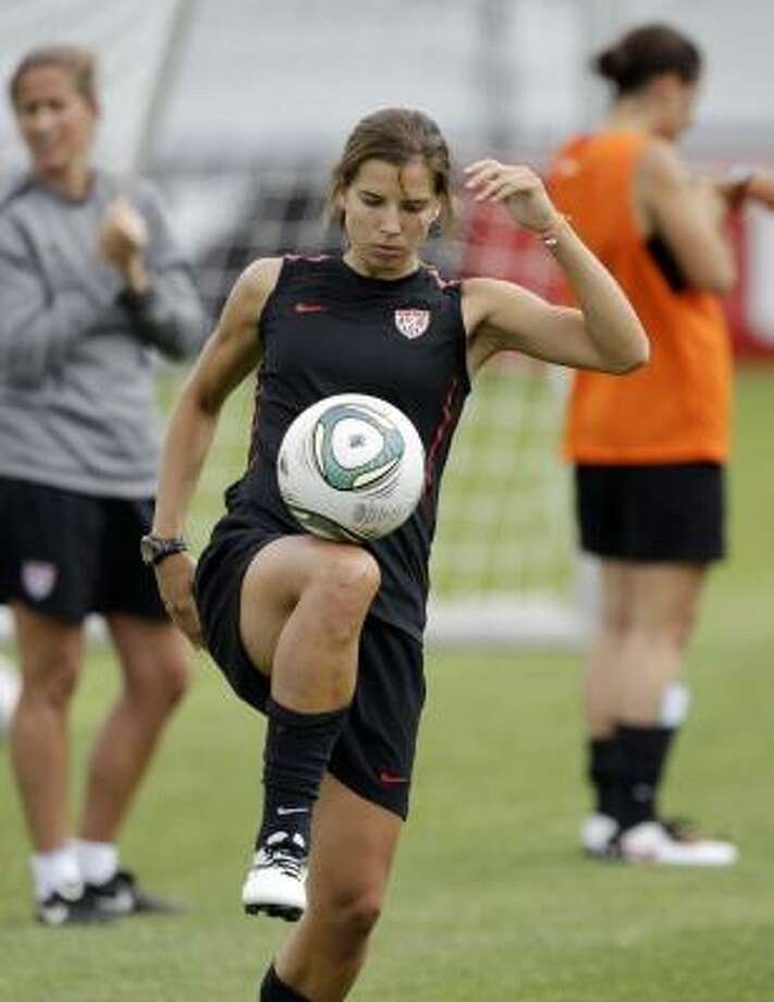 Tobin Heath juggles the ball during a U.S. team training session Saturday, one day before the start of the Women's World Cup in Germany. Photo: Marcio Jose Sanchez, Associated Press