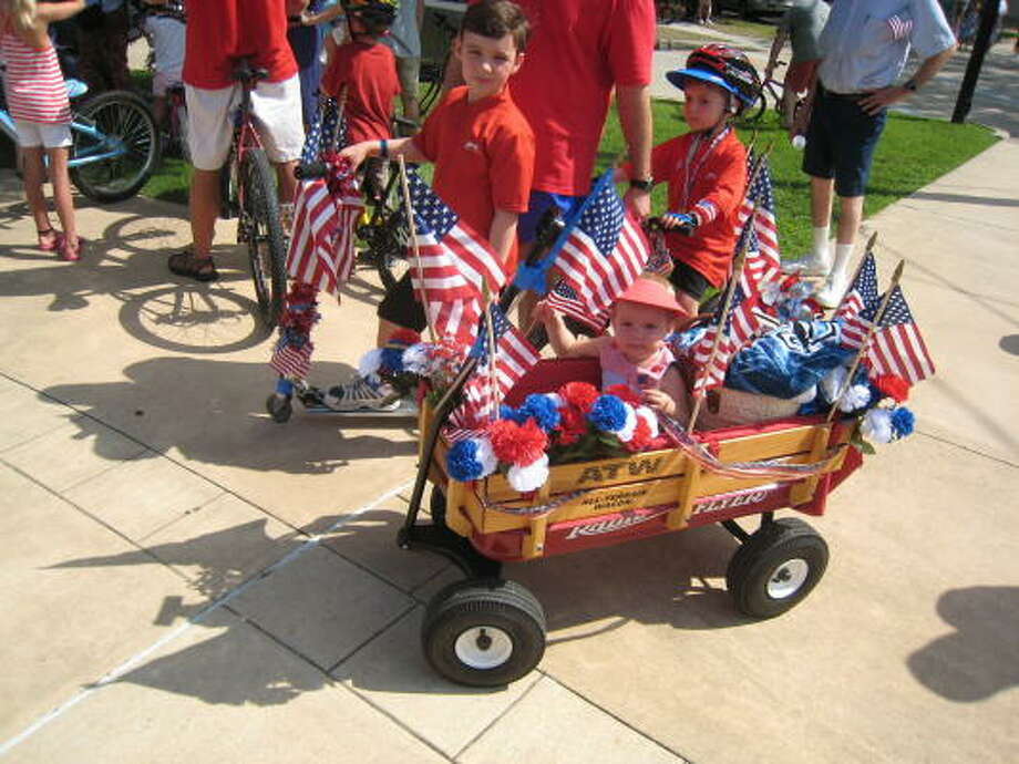 ALEX HAJ: FOR THE CHRONICLE HURRAH FOR THE RED WHITE AND BLUE: Residents of all ages took part in the West University Place July Fourth Parade. Photo: Alex Haj, For The Chronicle
