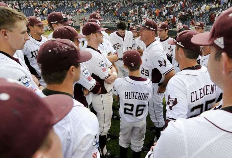 Texas A&M coach Rob Childress (29) address his players in the rain after losing to California 7-3 Tuesday. Photo: Eric Francis, Associated Press