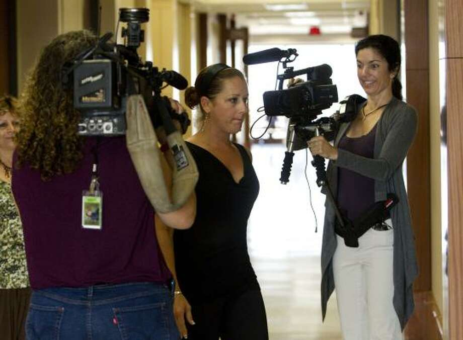 Nikki Araguz walks into the Harris County Criminal Justice Center while being filmed by documentarian Cressandra Thibodeaux, right, before Tuesday's court hearing. Photo: Johnny Hanson, Chronicle