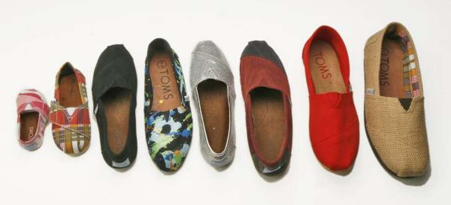For each pair of TOMS sold, founder Blake Mycoskie donates a pair to a needy person. Photo: BILL O'LEARY, WASHINGTON POST