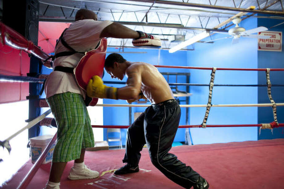 Regis Prograis, right, trains with Hylon Williams Sr. at Savannah Boxing Club in preparation for the Olympic trials. Photo: Nathan Lindstrom, Lindstrom Photography LLC