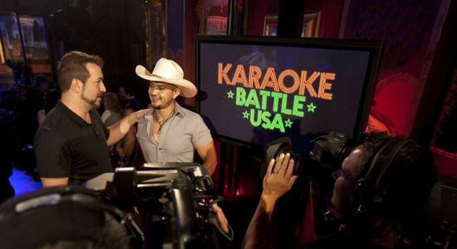 Karaoke Battle USA host Joey Fatone, left, talks with Felix Truvere, of San Antonio, after he sang She's Country during a taping of the auditions at House of Blues. Photo: Nick De La Torre, Houston Chronicle