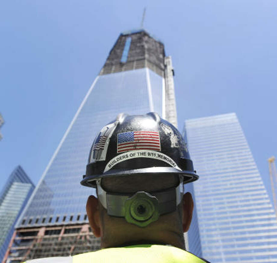 Chris Powers is one of the thousands of workers constructing the memorials at the Freedom Tower. Photo: Bob Luckey, Hearst Newspapers