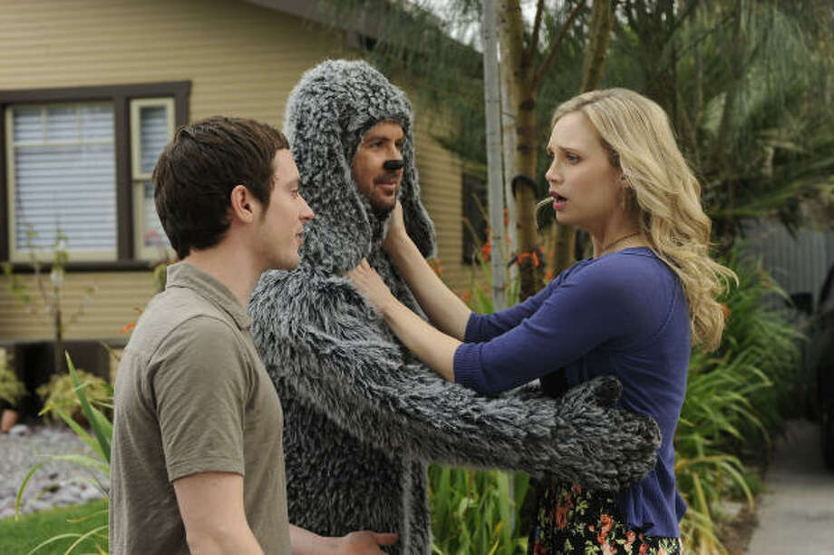 While Ryan (Elijah Wood, left) sees Wilfred (Jason Gann) as a man in a dog suit, his neighbor Jenna (Fiona Gubelmann) sees Wilfred as a dog. Photo: Ray Mickshaw/FX, FX