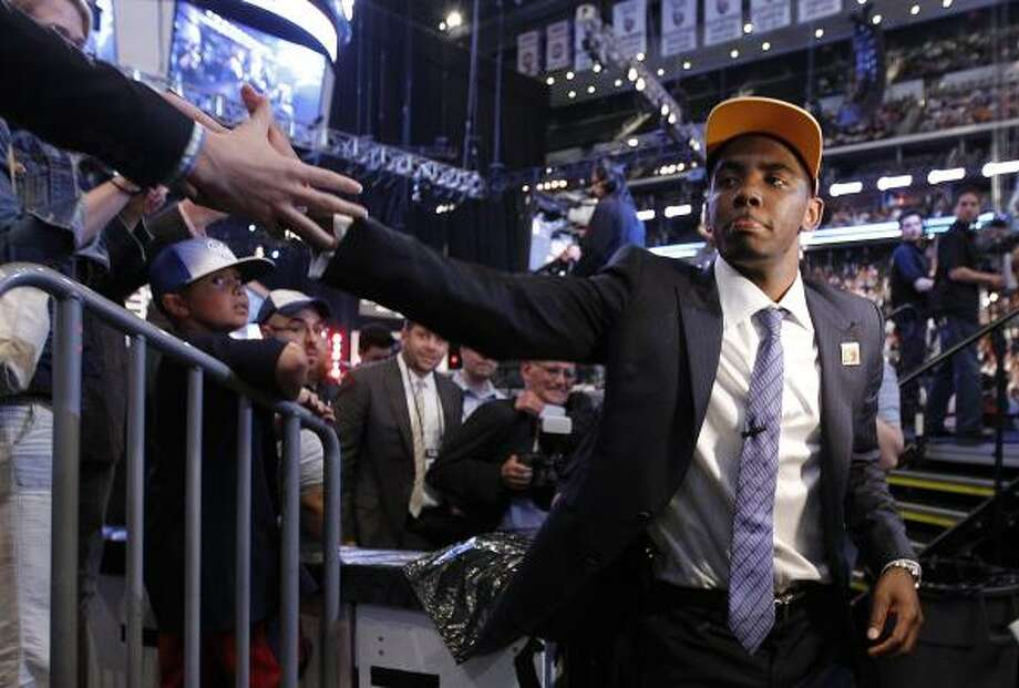 Kyrie Irving walks off the stage after the Cavaliers made him the No. 1 pick of the draft. Photo: Julio Cortez, Associated Press
