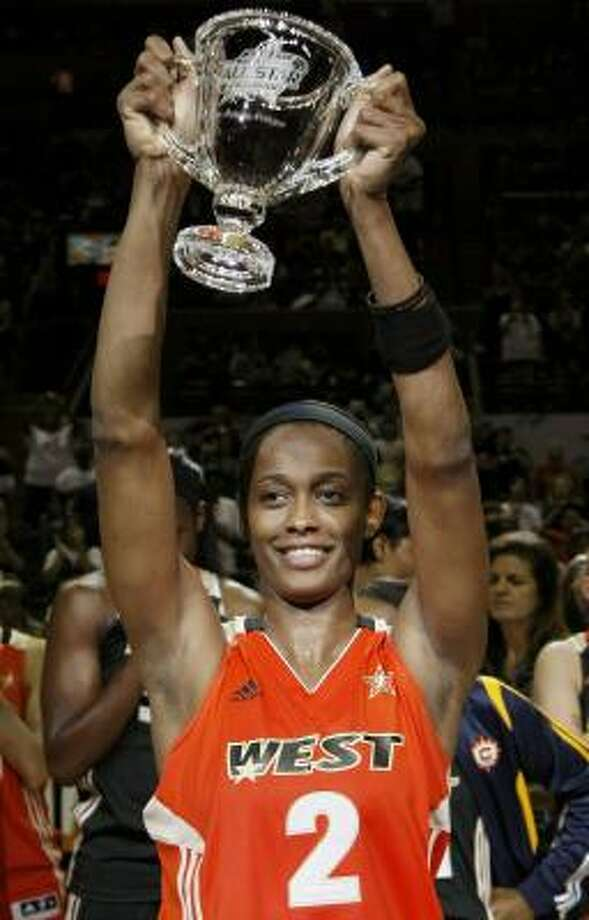 The West's Swin Cash holds up her MVP trophy after the WNBA All-Star Game on Saturday in San Antonio. Photo: Darren Abate, Associated Press