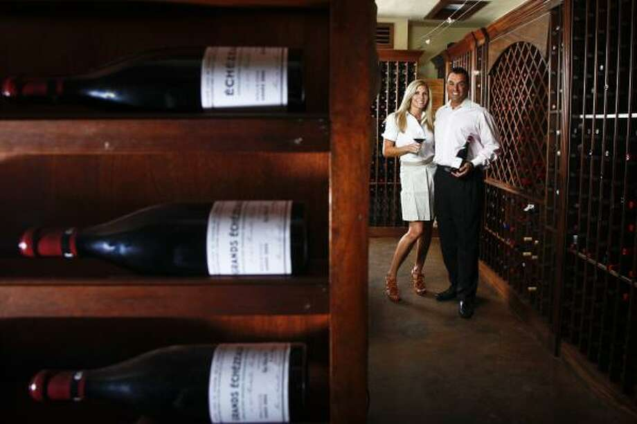 Gina and Dr. Devinder Bhatia have more than 6,500 bottles of wine in their cellar, which holds up to 14,000. They often host charity dinners in the space. Photo: Michael Paulsen, Houston Chronicle