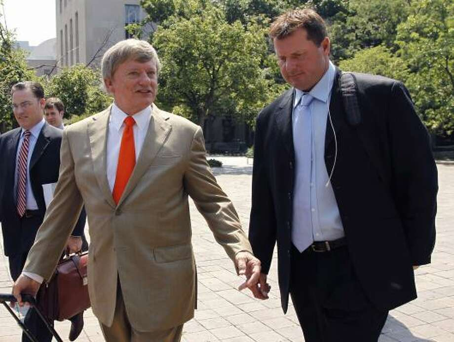 Attorney Rusty Hardin, left, and Roger Clemens leave federal court in Washington on Tuesday, the day before Clemens' perjury trial is scheduled to begin. Photo: Alex Brandon, Associated Press