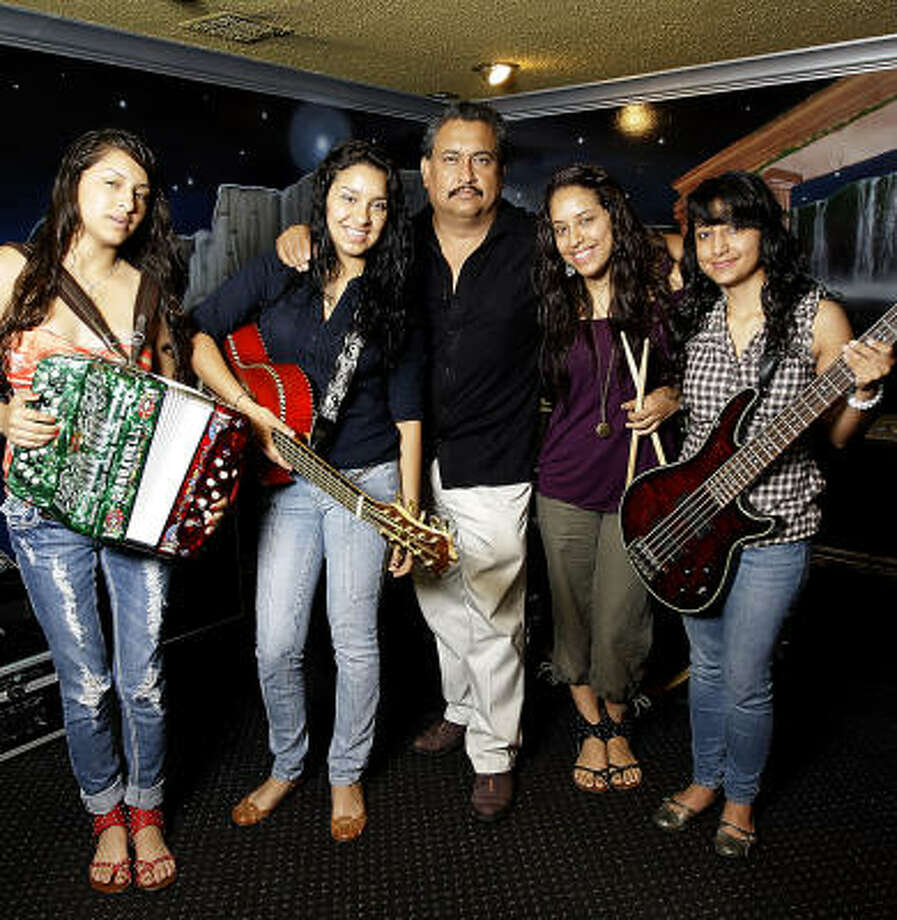 David Rodriguez, shown with the daughters who make up the group Las Fenix, knows he made a good choice all those years ago when he decided to seek his fortune in Houston. Photo: Karen Warren, Chronicle