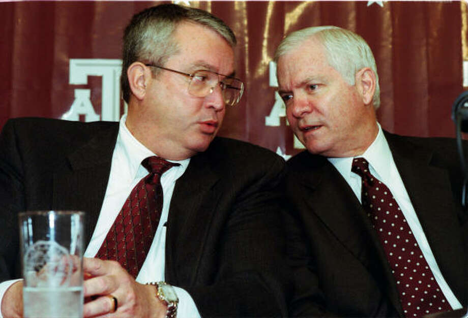 Bill Byrne's (left) Texas A&M was eighth nationally in the Division I Learfield Sports Directors' Cup standings, which measure across-the-board achievement on the field. Photo: Steve Ueckert, Chronicle File