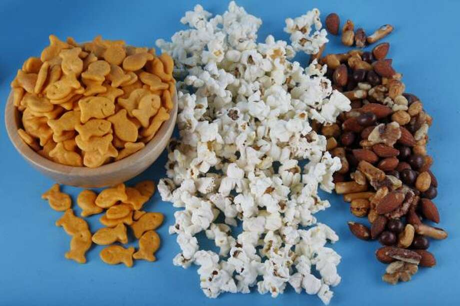 Try these healthful snacks for energy:  baked Pepperidge Farm Goldfish, Jolly TIme 100 Calorie popcorn and Planters NUT-rition Energy Mix Photo: Mayra Beltran, Chronicle