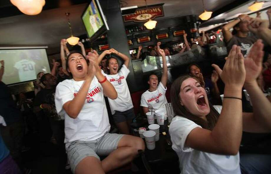 Austine Lin, left, and Kathleen Wiest, right, celebrate Abby Wambach's goal during Sunday's Women's World Cup final. Japan topped the U.S. on penalty kicks to win the title. Photo: Mayra Beltran, Chronicle