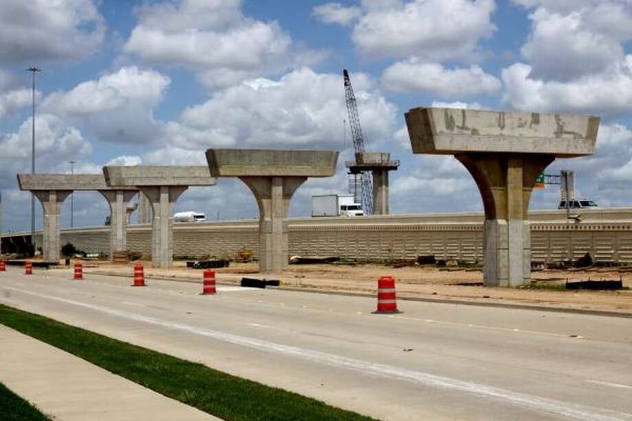 WORK ON SCHEDULE: Concrete bridge columns line the feeder road of Interstate 10 near the Grand Parkway. Photo: Suzanne Rehak, For The Chronicle