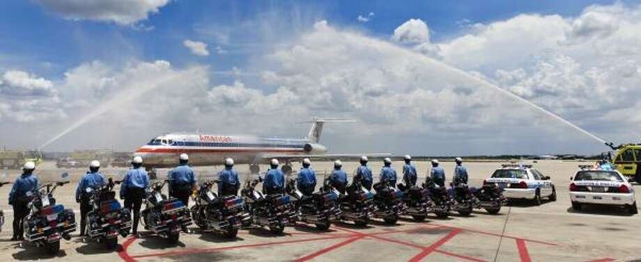 Houston police officers, Patriot Guard Riders, Navy personal and others gather Thursday at Bush Intercontinental Airport to receive the remains of U.S. Navy Lt. Cmdr. William Egan. Photo: Craig Hartley, Chronicle